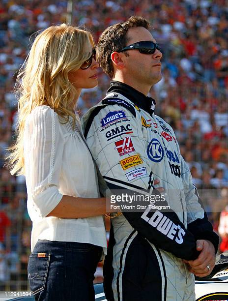 Jimmie Johnson stands with his wife Chandra before the NASCAR Nextel Cup series Dickies 500 race at Texas Motor Speedway in Fort Worth Texas Sunday...