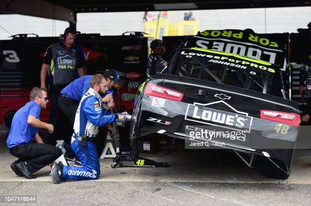 Jimmie Johnson takes the Lowe's for Pros Chevrolet to the garage after having issues during the Monster Energy NASCAR Cup Series Gander Outdoors 400...