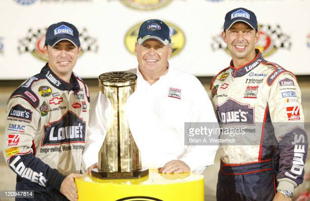 Jimmie Johnson Team Owner Rick Hendrick and Crew Chief Chad Knauss pose with the trophy after winning the CocaCola 600 at Lowe's Motor Speedway May...