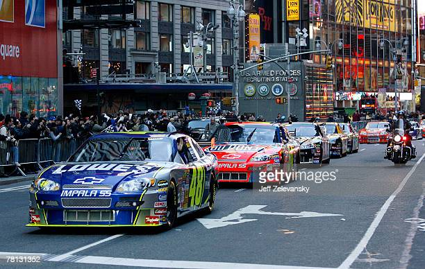 Jimmie Johnson, the 2007 NASCAR Nextel Cup Champion, driver of the Lowe's Chevrolet, leads Nextel Cup Series drivers in a victory lap through the...
