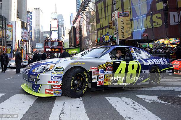 Jimmie Johnson, the 2007 NASCAR Nextel Cup Champion, drives the Lowe's Chevrolet, onto 7th Ave towards Time Square in a victory lap through the...