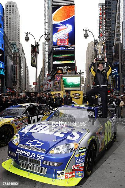 Jimmie Johnson, the 2007 NASCAR Nextel Cup Champion, poses on Military Island in Times Square during NASCAR Champions Week November 29, 2007 in New...