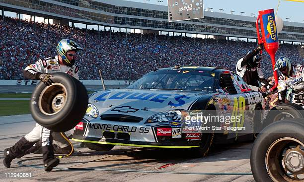 Jimmie Johnson's pit crew services the Lowe's Chevrolet during the NASCAR Nextel Cup series Dickies 500 race at Texas Motor Speedway in Fort Worth...