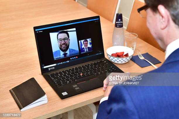 Jimmie Åkesson, party leader of the Swedish democrats, is displayed on a laptop screen as he attends a digital meeting with Andreas Norlén, speaker...