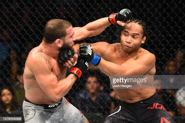 Jimmie Rivera punches John Dodson in their bantamweight fight during the UFC 228 event at American Airlines Center on September 8 2018 in Dallas Texas