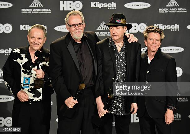 Jimmie Vaughan and inductees Reese Wynans Tommy Shannon and Chris Layton of Stevie Ray Vaughan and Double Trouble speak in the press room during the...