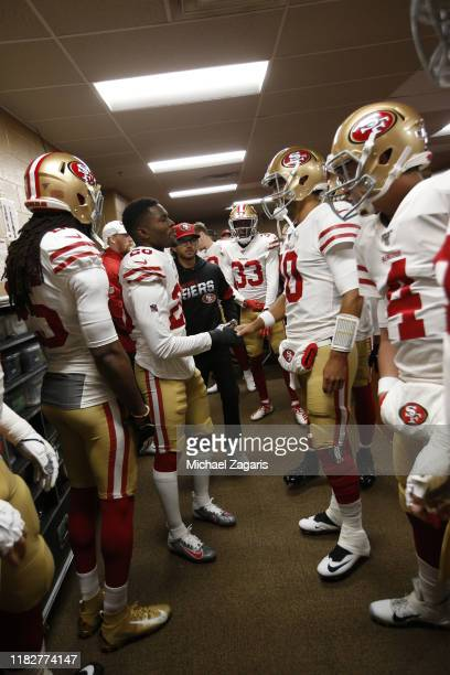 Jimmie Ward and Jimmy Garoppolo of the San Francisco 49ers talk in the locker room prior to the game against the Washington Redskins at FedExField on...