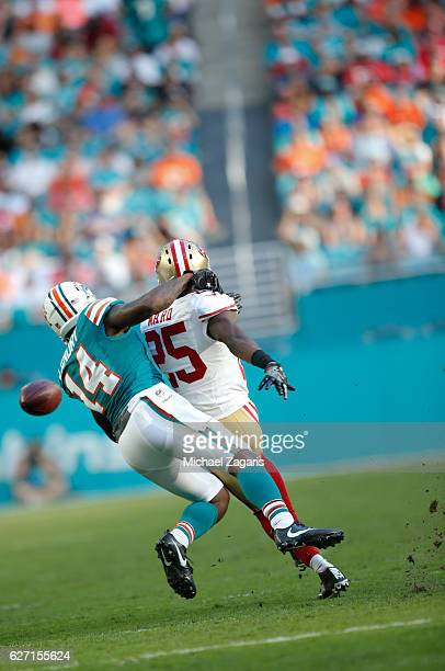 Jimmie Ward of the San Francisco 49ers breaks up a pass to Jarvis Landry of the Miami Dolphins during the game at Hard Rock Stadium on November 27...