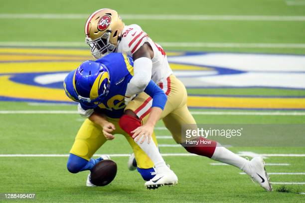 Jimmie Ward of the San Francisco 49ers forces a fumble by Jared Goff of the Los Angeles Rams during the second quarter at SoFi Stadium on November...