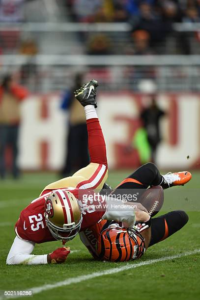 Jimmie Ward of the San Francisco 49ers sacks AJ McCarron of the Cincinnati Bengals during their NFL game at Levi's Stadium on December 20 2015 in...