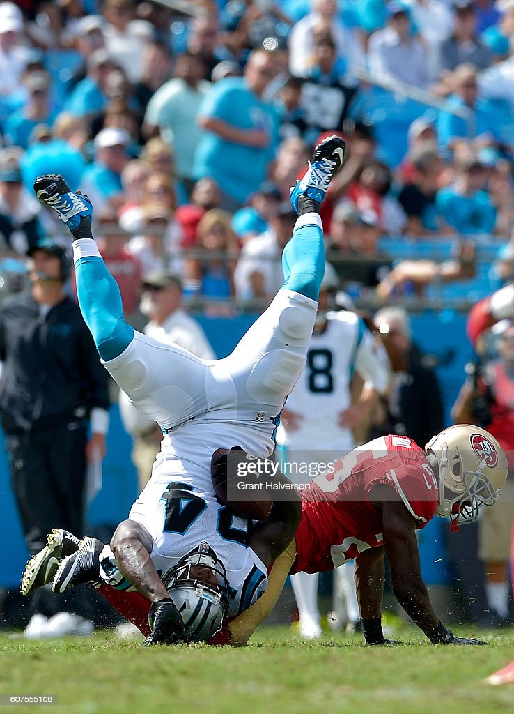 Jimmie Ward #25 of the San Francisco 49ers tackles Ed Dickson #84 of the Carolina Panthers in the 3rd quarter during the game at Bank of America Stadium on September 18, 2016 in Charlotte, North Carolina.