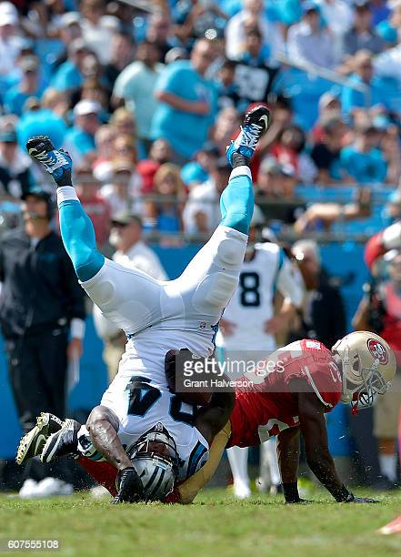 Jimmie Ward of the San Francisco 49ers tackles Ed Dickson of the Carolina Panthers in the 3rd quarter during the game at Bank of America Stadium on...