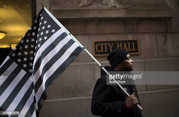 Jimmie Williams joins demonstrators in a protest outside of City Hall calling on Mayor Rahm Emanuel to resign on December 11 2015 in Chicago Illinois...