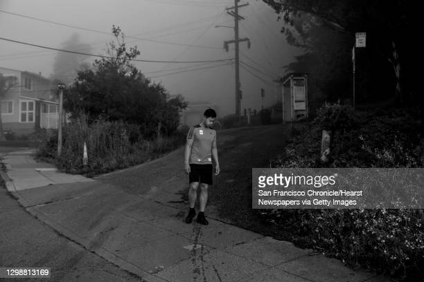 Lansdale Avenue and Dalewood Way) Jimmie Wu pauses as he gets ready to run back to the van he lives in after running up Mt. Davidson on the morning...
