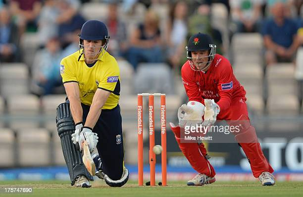 Jimmy Adams of Hampshire reverse sweeps his first ball to the boundary as Gareth Cross of Lancashire looks onduring the Friends Life T20 Quarter...