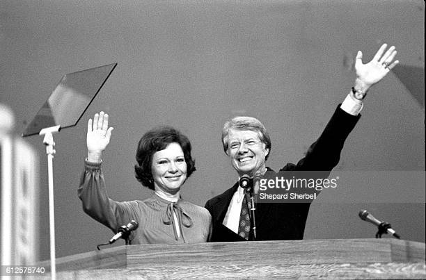Jimmy and Rosalynn Carter wave to assembled Democratic National Convention after he accepted his party's nomination for president