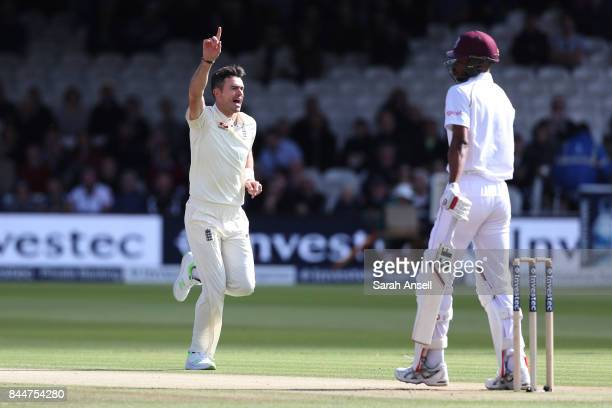 Jimmy Anderson of England celebrates taking the wicket of Roston Chase of West Indies during the first over on day three of the 3rd Investec Test...