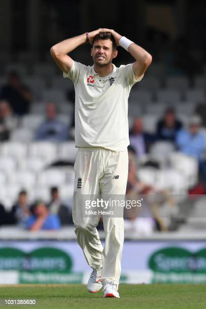 Jimmy Anderson of England reacts after seeing Jonny Bairstow drop a difficult chance during the Specsavers 5th Test Day Five between England and...