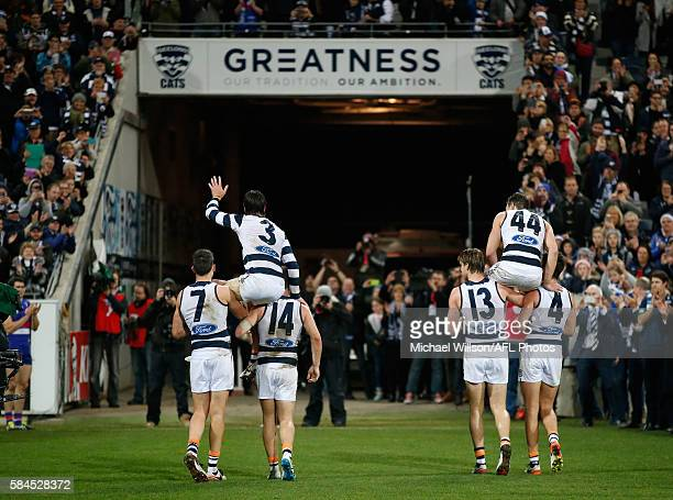 Jimmy Bartel and Corey Enright of the Cats are chaired from the field after the 2016 AFL Round 19 match between the Geelong Cats and the Western...