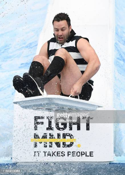 Jimmy Bartel goes down the Freeze MND slide before the round 12 AFL match between the Collingwood Magpies and the Melbourne Demmons at Melbourne...