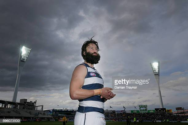 Jimmy Bartel of the Cats acknowledges the fans after the round 23 AFL match between the Geelong Cats and the Melbourne Demons at Simonds Stadium on...