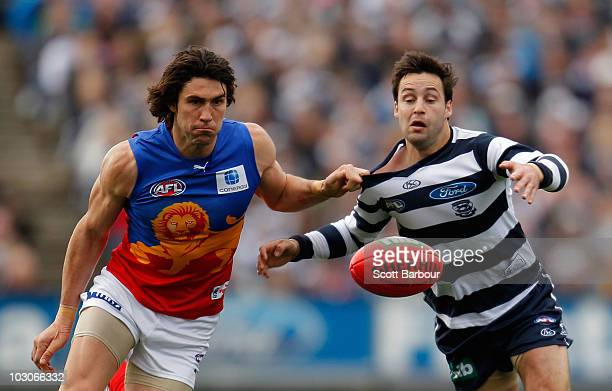Jimmy Bartel of the Cats and Brent Staker of the Lions compete for the ball during the round 17 AFL match between the Geelong Cats and the Brisbane...