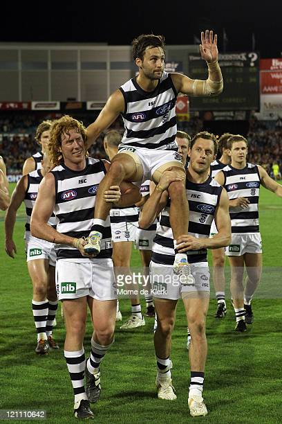 Jimmy Bartel of the Cats is chaired off after playing in his 200th game after the round 21 AFL match between the Adelaide Crows and the Geelong Cats...