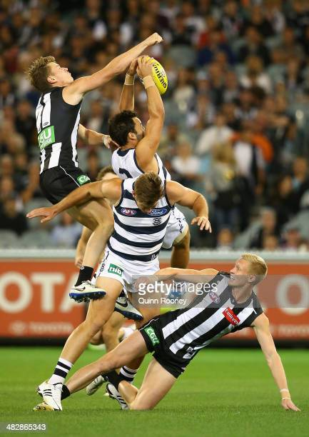 Jimmy Bartel of the Cats marks infront of Tom Langdon of the Magpies during the round three AFL match between the Collingwood Magpies and the Carlton...