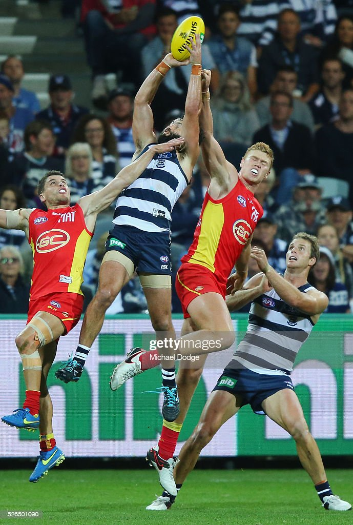 Jimmy Bartel of the Cats marks the ball against Peter Wright of the Suns during the round six AFL match between the Geelong Cats and the Gold Coast Suns at Simonds Stadium on April 30, 2016 in Geelong, Australia.