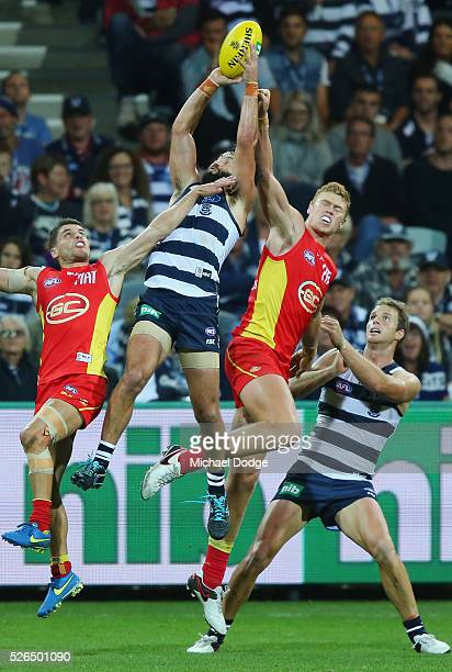 Jimmy Bartel of the Cats marks the ball against Peter Wright of the Suns during the round six AFL match between the Geelong Cats and the Gold Coast...