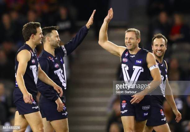 Jimmy Bartel of Victoria is congratulated by his teammates after kicking a super goal during the 2017 EJ Whitten Legends Game between Victoria and...