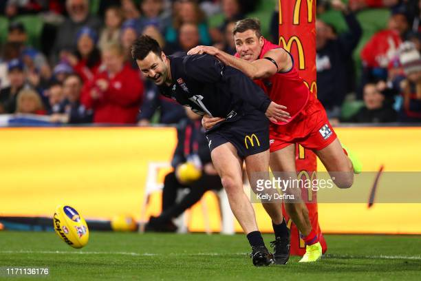 Jimmy Bartel of Victoria is tackled by Matthew Richardson of the All-Stars during the EJ Whitten Legends Match at AAMI Park on August 30, 2019 in...