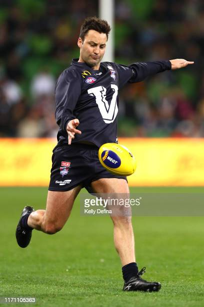 Jimmy Bartel of Victoria kicks the ball during the EJ Whitten Legends Match at AAMI Park on August 30, 2019 in Melbourne, Australia.