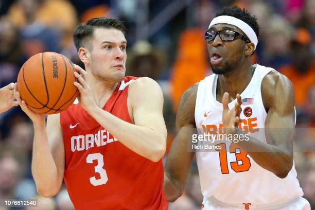 Jimmy Boeheim of the Cornell Big Red looks to pass as Paschal Chukwu of the Syracuse Orange defends during the second half at the Carrier Dome on...