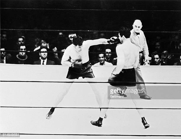 Jimmy Braddock sticks a left jab in Max Baer's face in the first round of their championship fight at Madison Square Garden June 13 1935 Braddock the...