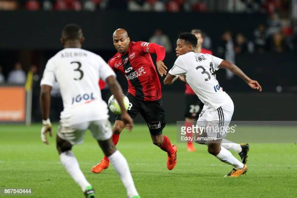 Jimmy Briand of Guingamp and Bongani Zungu of Amiens during the Ligue 1 match between EA Guingamp and Amiens SC at Stade du Roudourou on October 28...