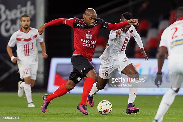 Jimmy Briand of Guingamp and Ibrahima Amadou of Lille during the Ligue 1 match between EA Guingamp and Lille OCS at Stade du Roudourou on October 15,...