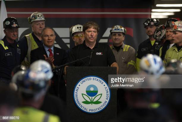 Jimmy Brock CEO of CNX Coal Resources introduces US Environmental Protection Agency Administrator Scott Pruitt during an event at the Harvey Mine on...