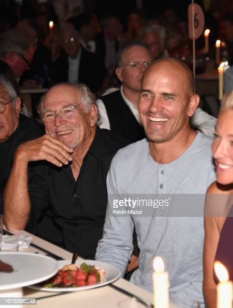 Jimmy Buffett and Kelly Slater attends Apollo in the Hamptons 2018 Hosted by Ronald O Perelman at The Creeks on August 11 2018 in East Hampton New...