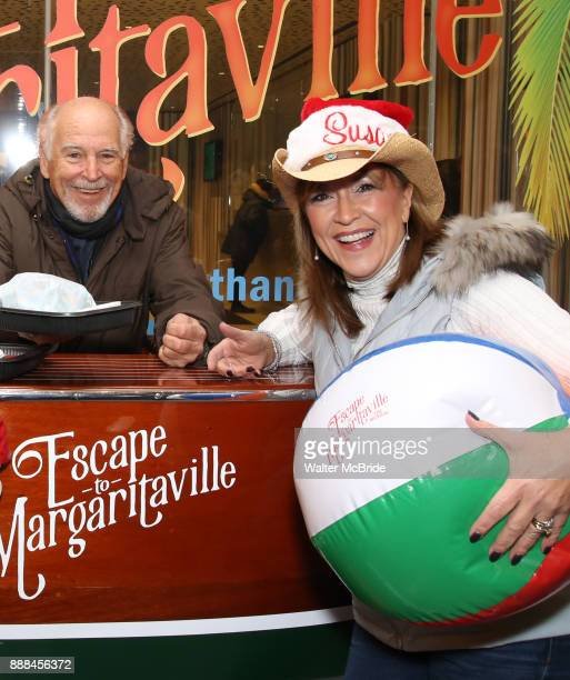 Jimmy Buffett hands out free hamburgers as he offically opens up the Box Office for his Broadway Musical 'Escape To Margaritaville' at the Marquis...