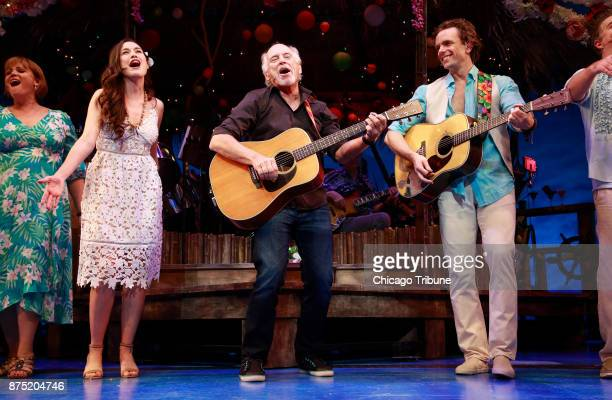 Jimmy Buffett surprises theater goers during the curtain call for 'Escape to Margaritaville' at the Oriental Theatre on Wednesday Nov 15 2017