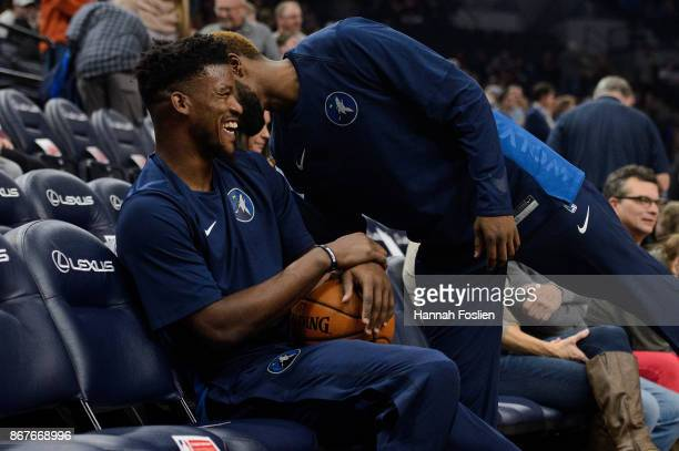 Jimmy Butler and Aaron Brooks of the Minnesota Timberwolves speak before the game against the Oklahoma City Thunder on October 27, 2017 at the Target...