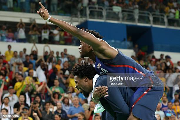 Jimmy Butler and DeAndre Jordan of United States celebrate after defeating China on Day 1 of the Rio 2016 Olympic Games at Carioca Arena 1 on August...