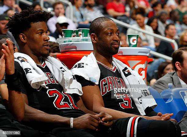 Jimmy Butler and Dwyane Wade of the Chicago Bulls look on from the bench during the game against the Atlanta Hawks at Philips Arena on January 20...
