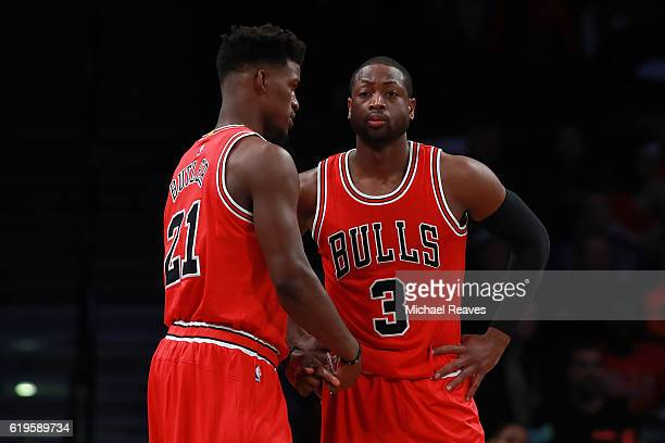 Jimmy Butler and Dwyane Wade of the Chicago Bulls talk during a free throw against the Brooklyn Nets during the first half at Barclays Center on...