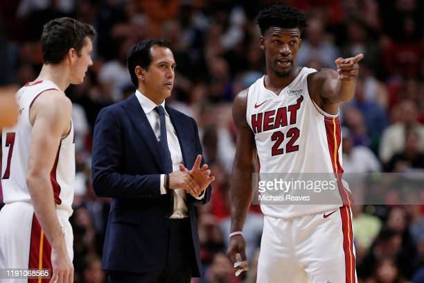 Jimmy Butler and Goran Dragic of the Miami Heat talk with head coach Erik Spoelstra against the Detroit Pistons during the second half at American...