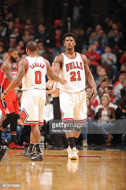 Jimmy Butler and Isaiah Canaan of the Chicago Bulls shake hands during the game against the Washington Wizards on November 12 2016 at the United...