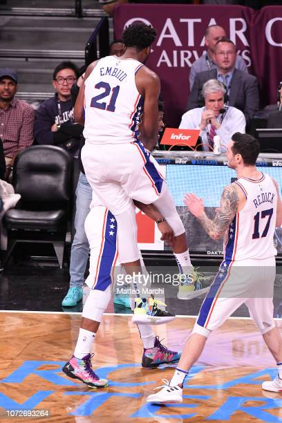 Jimmy Butler and Joel Embiid of the Philadelphia 76ers celebrate after the game winning shot during the game against the Brooklyn Nets at Barclays...