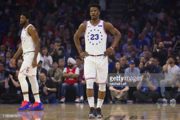 Jimmy Butler and Joel Embiid of the Philadelphia 76ers look on against the Toronto Raptors in Game Six of the Eastern Conference Semifinals at the...