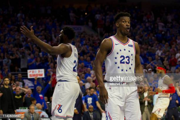 Jimmy Butler and Joel Embiid of the Philadelphia 76ers react after a foul was called on Embiid against the Toronto Raptors in the fourth quarter of...